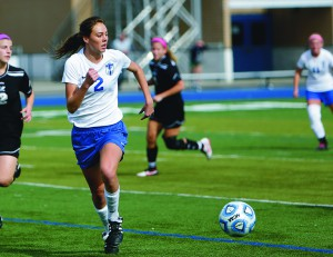 Olivia Huber on the soccer field, intense and competitive describe her approach to sports. Photo by Joe Humphries